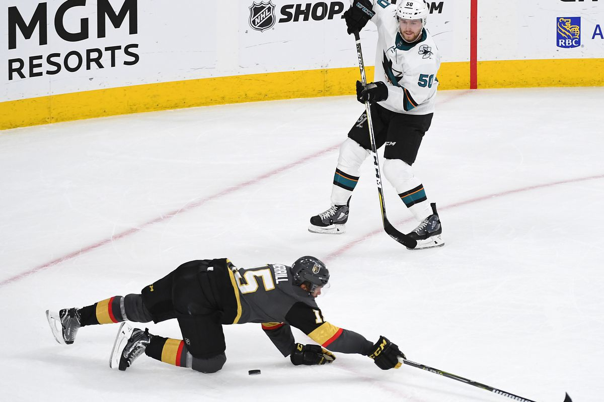 Apr 26, 2018; Las Vegas, NV, USA; San Jose Sharks center Chris Tierney (50) fires a pass against Vegas Golden Knights defenseman Jon Merrill (15) during the third period of game one of the second round of the 2018 Stanley Cup Playoffs at T-Mobile Arena.&n
