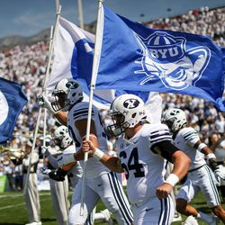 Brigham Young Cougars players enter the field before the game against the Wisconsin Badgers at LaVell Edwards Stadium in Provo on Saturday, Sept. 16, 2017.