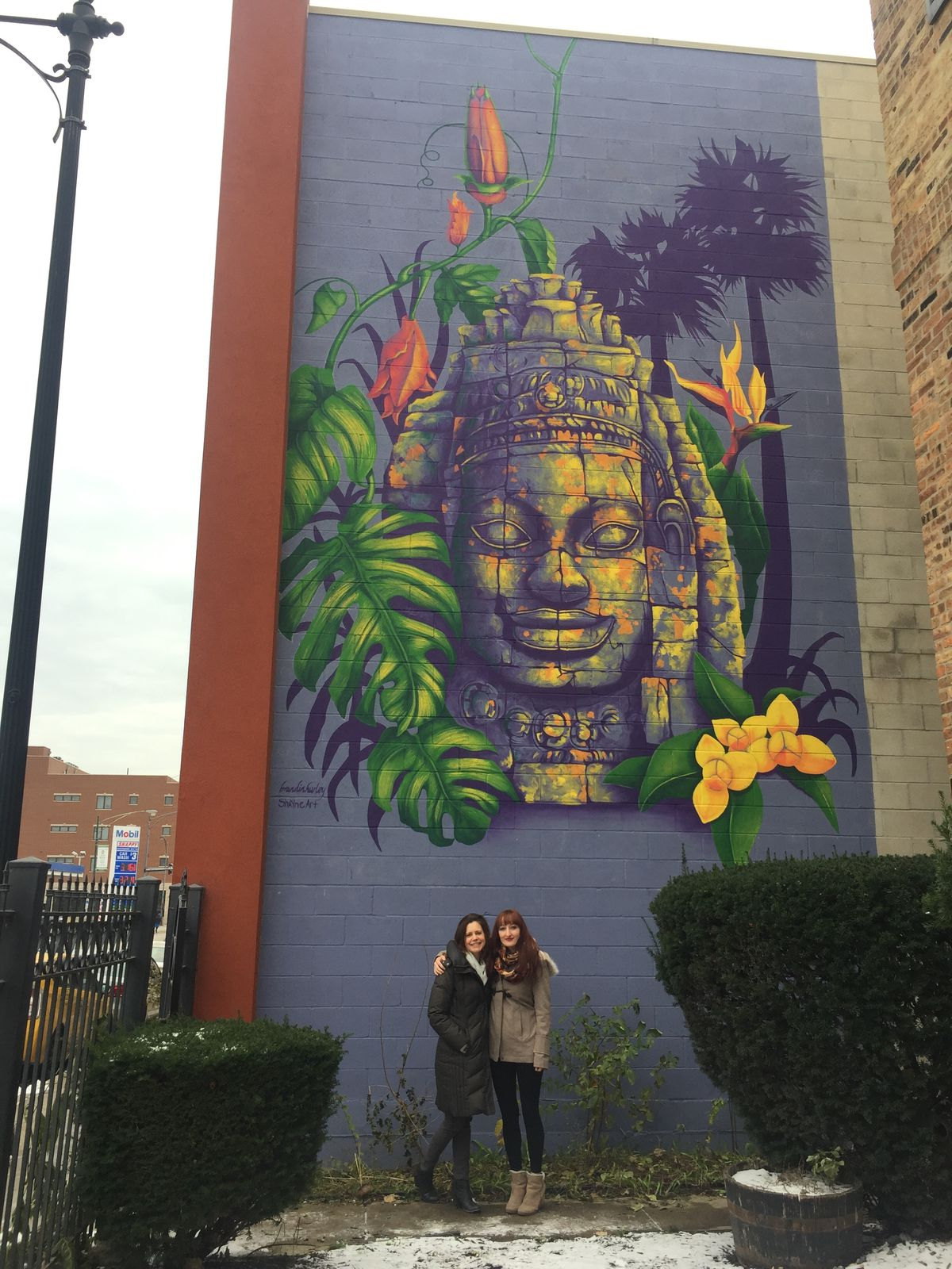 """The mural, """"Cambodian Color,"""" was painted by artists Brandin Hurley (right) and Shayne Renee Taylor."""