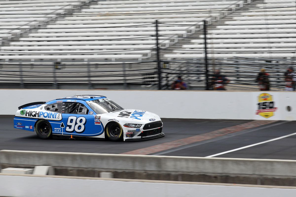 Chase Briscoe, driver of the #98 Highpoint.com Ford, crosses the finish line to win the the NASCAR Xfinity Series Pennzoil 150 at the Brickyard at Indianapolis Motor Speedway on July 04, 2020 in Indianapolis, Indiana.