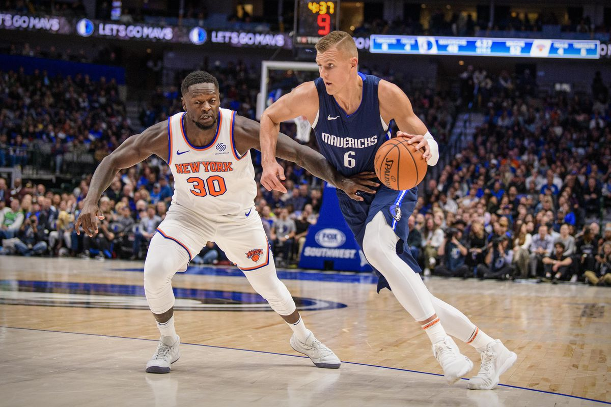 New York Knicks forward Julius Randle and Dallas Mavericks forward Kristaps Porzingis in action during the game between the Mavericks and the Knicks at the American Airlines Center.