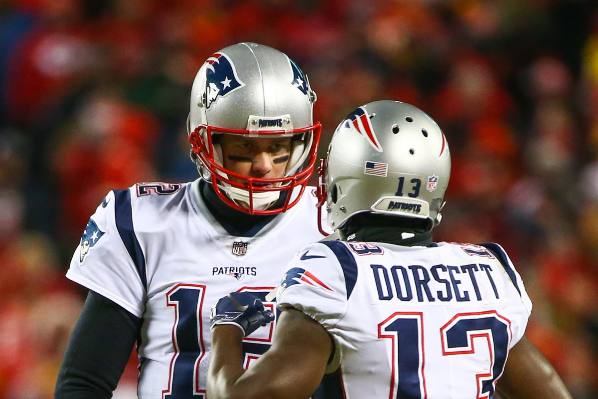 New England Patriots quarterback Tom Brady talks with wide receiver Phillip Dorsett during the AFC Championship game against the Kansas City Chiefs at Arrowhead Stadium.