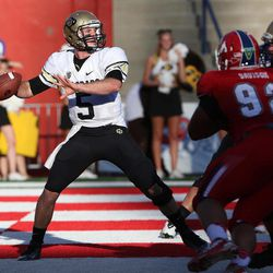 Colorado's Connor Wood looks to throw from his own end zone against Fresno State in the first quarter of an NCAA college football game in Fresno, Calif., Saturday, Sept. 15, 2012.