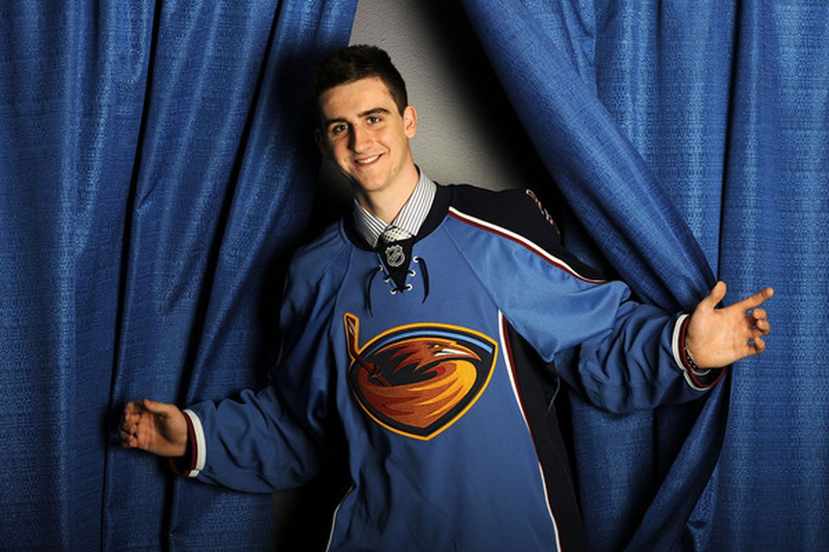 Julian Melchiori, having fun at the photo session for the draftees. The Thrashers' jersey meshes well with the curtains and with Melchiori.