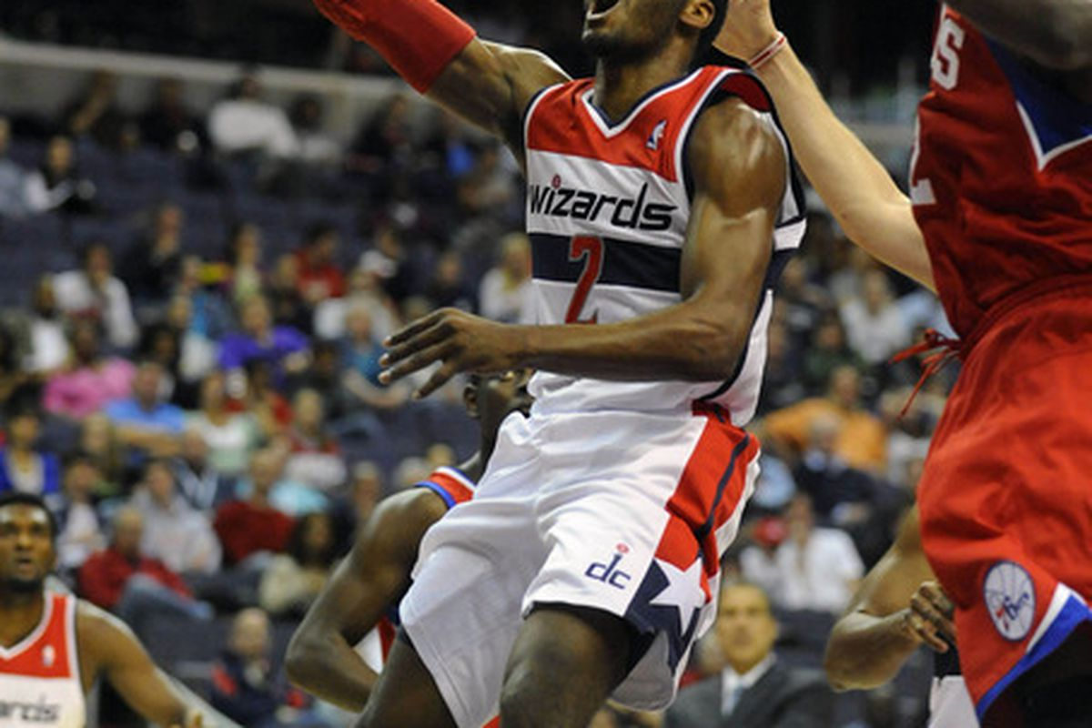 Mar 30, 2012; Washington, DC, USA; Washington Wizards point guard John Wall (2) attempts a lay up as Philadelphia 76ers power forward Elton Brand (right) defends during the first half at the Verizon Center. Mandatory Credit: Brad Mills-US PRESSWIRE