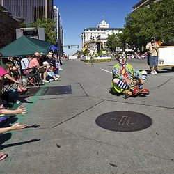 Spectators watch as the floats, horses and celebrities participate in the Days of '47 Parade in Salt Lake City Saturday.