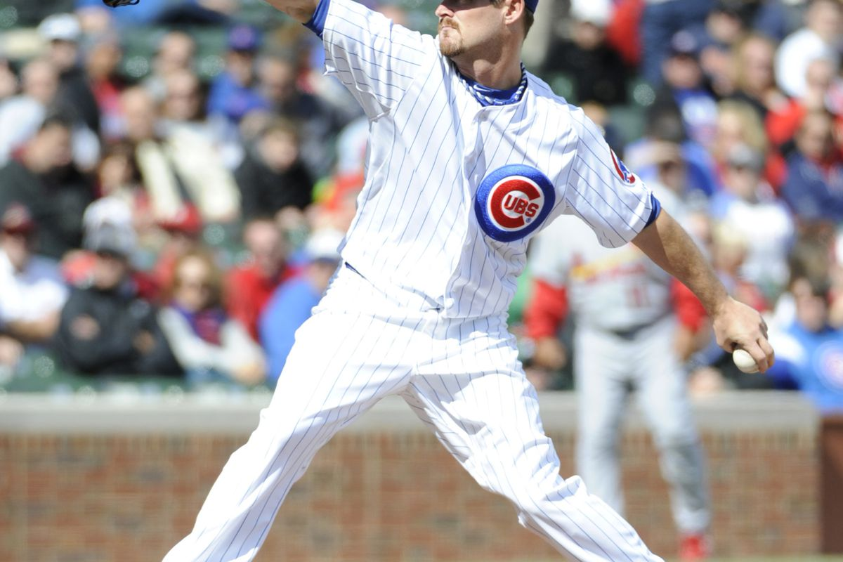 Travis Wood of the Chicago Cubs pitches against the St. Louis Cardinals at Wrigley Field in Chicago, Illinois.  (Photo by David Banks/Getty Images)