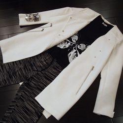 Ashley B Ivory Tweed Jacket, $625; Lauren Moshi Skull Top, $93; Evocateur Cuffs, $286 each