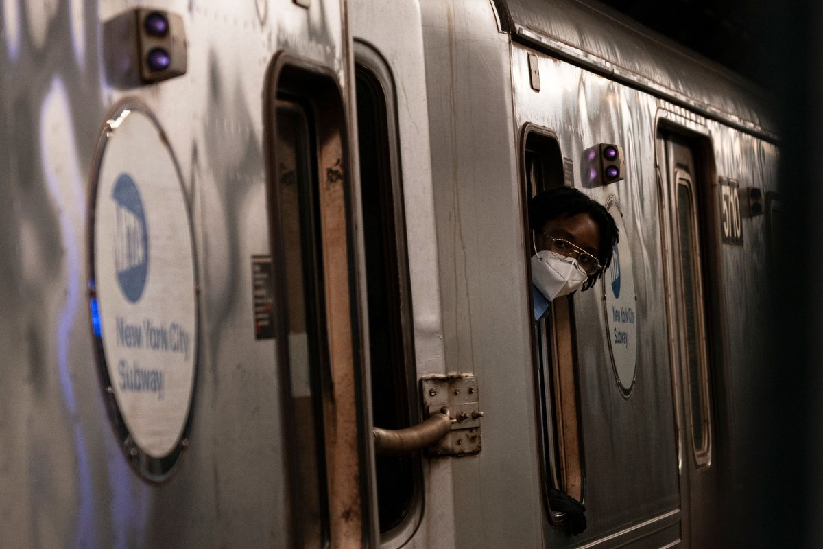 A conductor wears a mask as a subway train leaves the station. June 12, 2020.