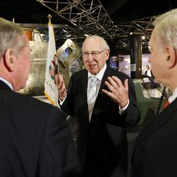 """Captain James A. Lovell, Jr, center, speaks with President and CEO of Chicago's Museum of Science and Industry, David R. Mosena, right, and journalist Frank Mathie, left, during 45th Anniversary of Apollo 8 """"Christmas Eve Broadcast to Earth"""" event at the Museum of Science and Industry in Chicago, Monday, Dec. 23, 2013."""