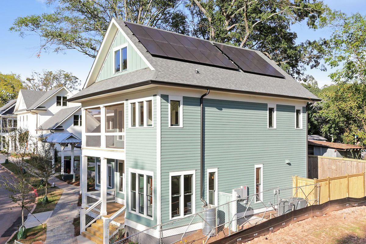 A photo of solar panels on a house at La France Walk.