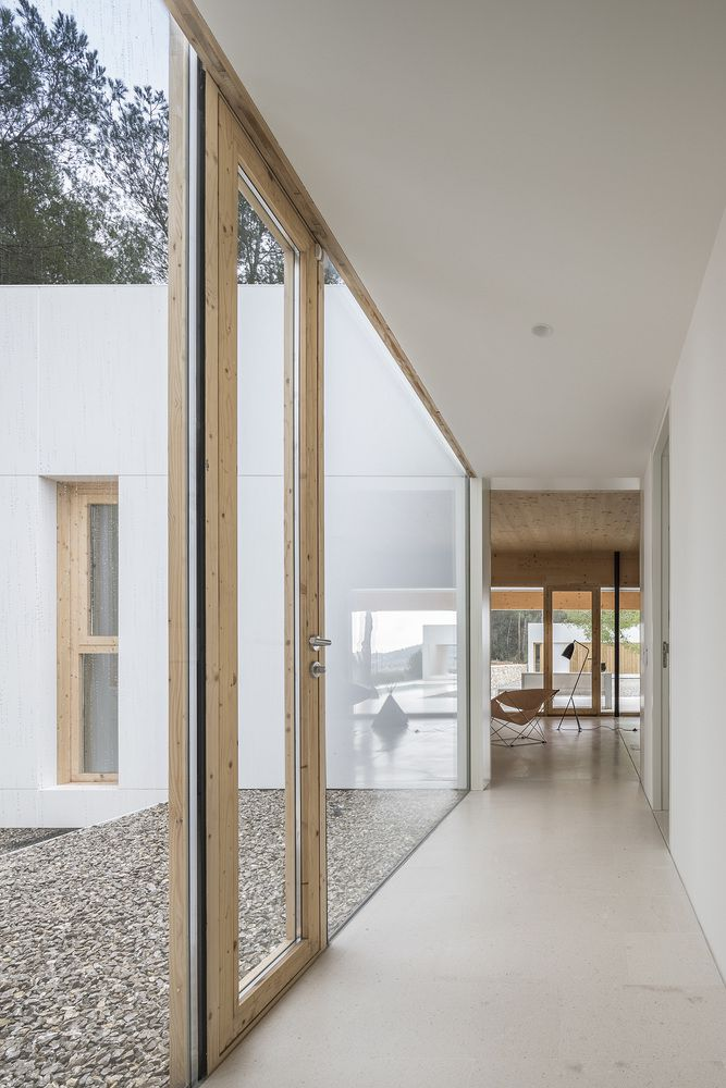 Glass-clad hallway leading to living room.