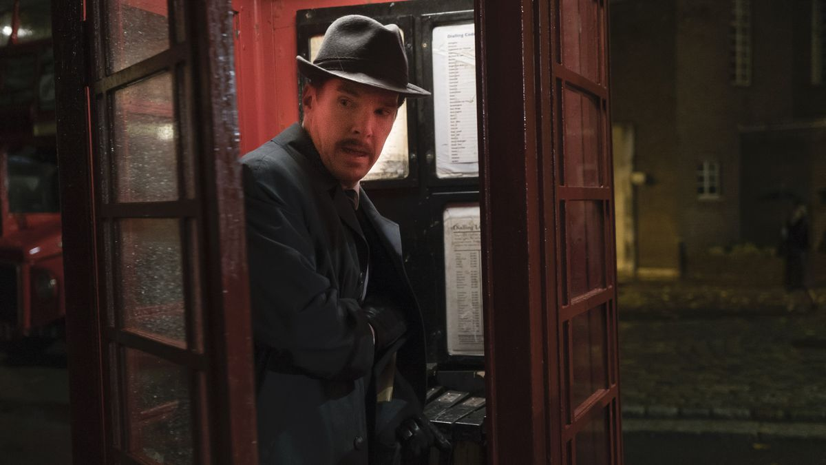Benedict Cumberbatch is in a phone booth, frightened.