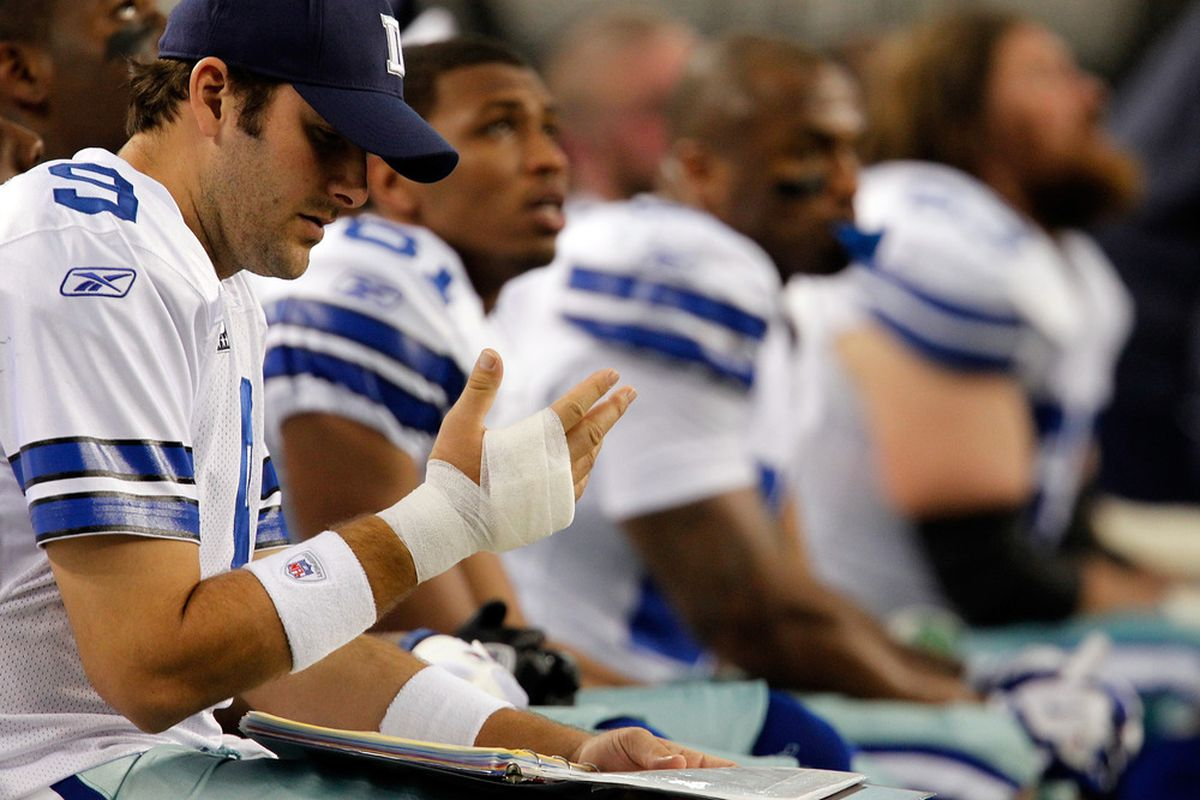 ARLINGTON, TX - DECEMBER 24:   Tony Romo #9 of the Dallas Cowboys sits on the sidelines with an injured hand against the Philadelphia Eagles at Cowboys Stadium on December 24, 2011 in Arlington, Texas.  (Photo by Tom Pennington/Getty Images)
