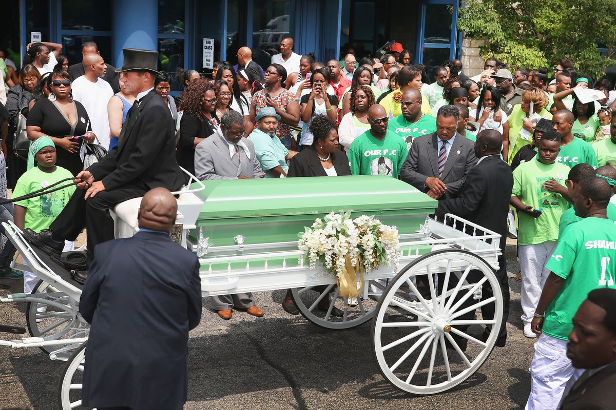 Chicagoans, including Jesse Jackson, gather for the funeral of Shamiya Adams, an 11-year-old girl killed by a stray bullet.