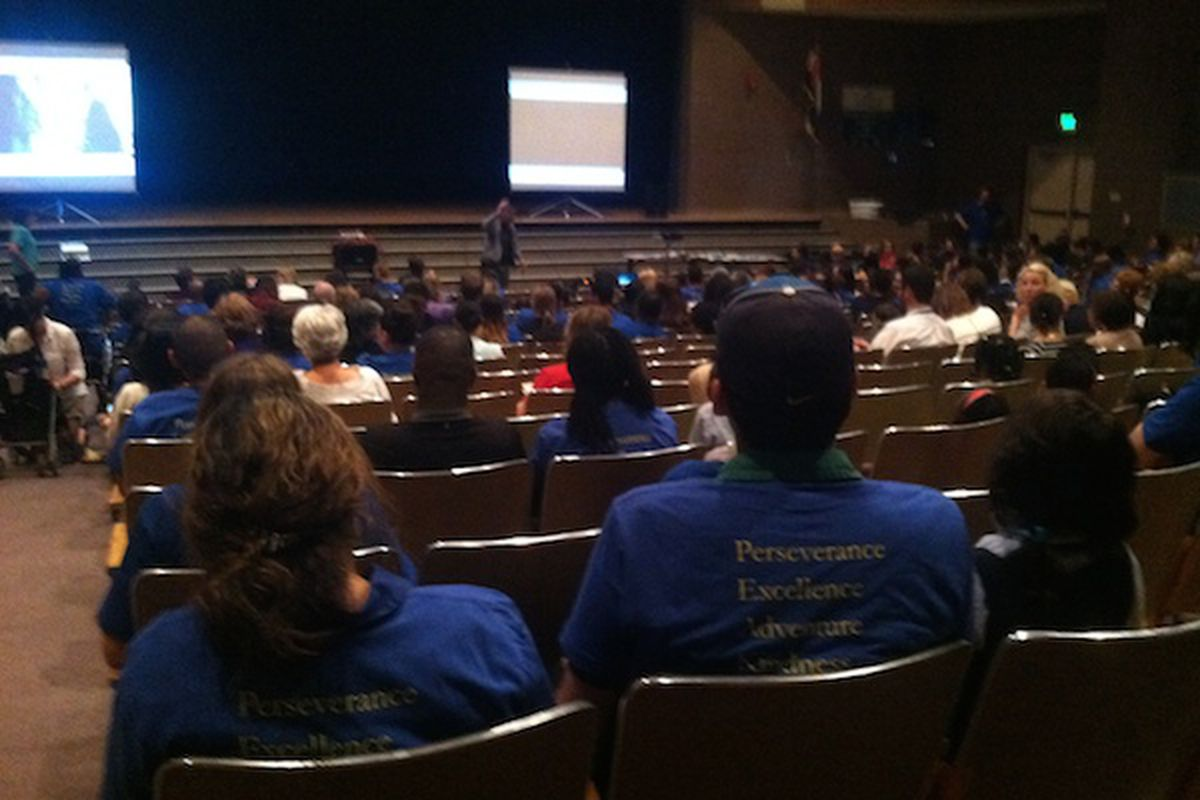 The blue t-shirts of Rocky Mountain Prep dominate the Hampden Heights community meeting.