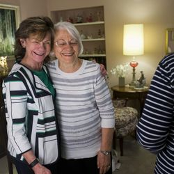 Former Utah First Lady Norma Matheson hugs Linda Kruse as she attends a monthly book club at the home of Carol McFarland on Thursday, April 20, 2017.
