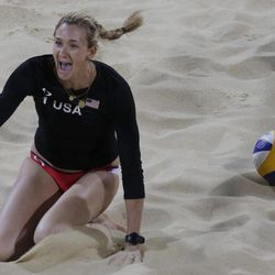 Kerri Walsh of the United States reacts after making a point during a beach volleyball match against Australia at the 2012 Summer Olympics, Saturday, July 28, 2012, in London.