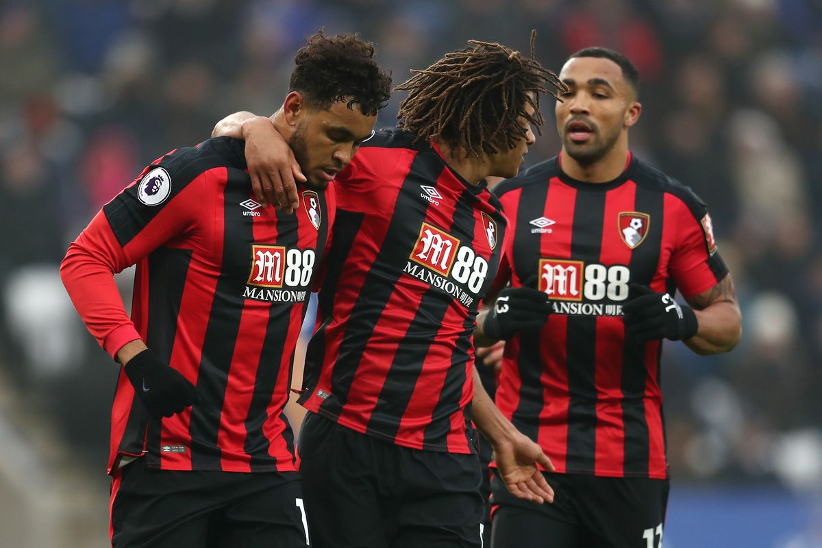 Joshua King celebrates scoring his side's first goal with Nathan Ake and Callum Wilson - AFC Bournemouth - Premier League