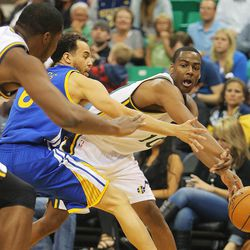 Utah's Alec Burks passes to teammate Derrick Favors as the Utah Jazz and the Golden State Warriors play Tuesday, Oct. 8, 2013 in preseason action at Energy Solutions arena in Salt Lake City.