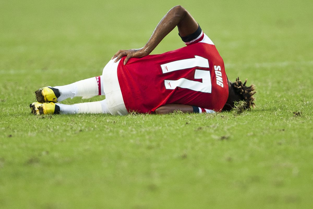 SO KON PO, HONG KONG - JULY 29:  Alex Song of Arsenal FC lies on the ground during the pre-season Asian Tour friendly match between Kitchee FC and Arsenal at Hong Kong Stadium on July 29, 2012 in Hong Kong.  (Photo by Victor Fraile/Getty Images)