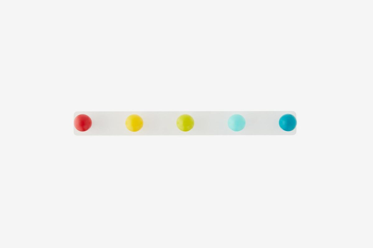 Horizontal white hanger with multi-colored spherical knobs.