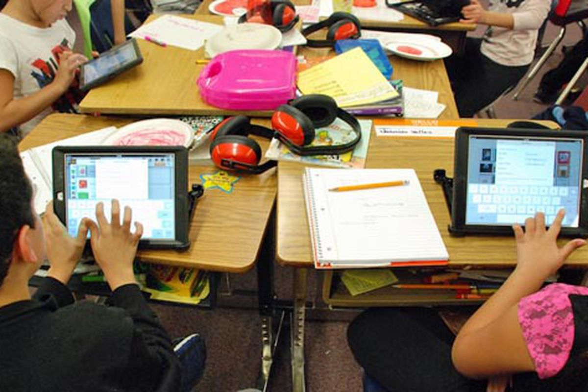 Students at Lumberg Elementary School in Jefferson County work on their assigned iPads during a class project. Photo by Nicholas Garcia