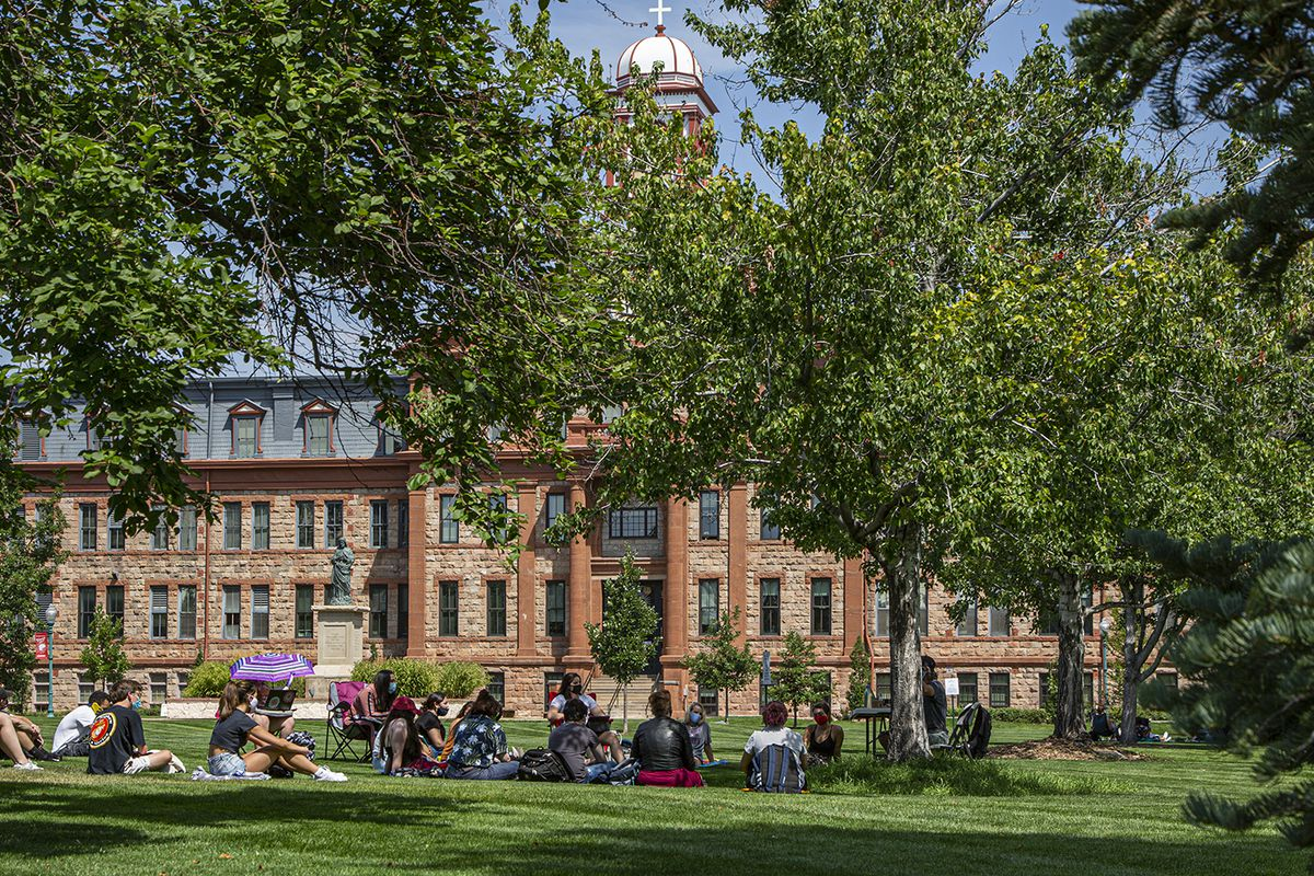 Regis University students gather outside for class during the first week of the 2020 fall semester.