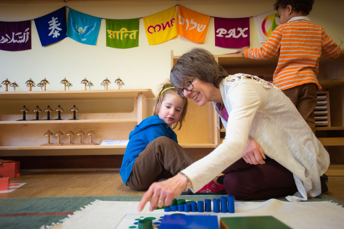 A teacher works with a student at Marigold Montessori School in Haverhill, Mass., which is part of the Wildflower Schools network.