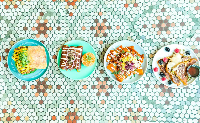 Four plates set against a colorful tiled background