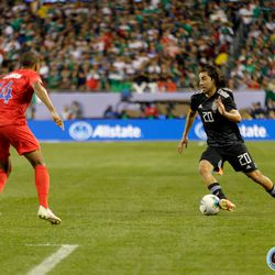 July 7, 2019 - Chicago, Illinois, United States - USA defender Reggie Cannon (14) marks Mexico forward Rodolfo Pizarro (20) during the Gold Cup Final at Soldier Field.