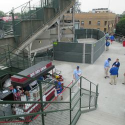 """6:26 p.m. View from the right-field porch, looking at the future """"Platform 14"""" space, on the bleacher patio walkway behind center field -"""