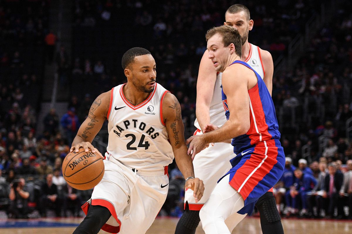 Toronto Raptors guard Norman Powell drives to the basket as center Marc Gasol sets a pick against Detroit Pistons guard Luke Kennard during the first quarter at Little Caesars Arena.