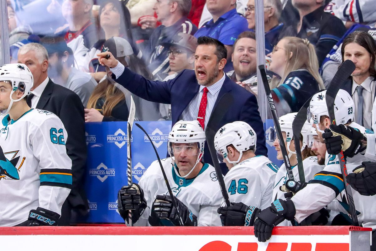 WINNIPEG, MB - FEBRUARY 14: Head Coach Bob Boughner of the San Jose Sharks makes a point at the bench during third period action against the Winnipeg Jets at the Bell MTS Place on February 14, 2020 in Winnipeg, Manitoba, Canada.