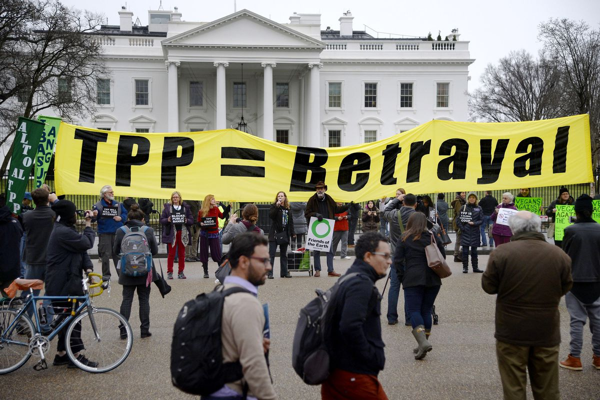 Activists hold a rally to protest the Trans-Pacific Partnership (TPP) in front of the White house on February 3, 2016, in Washington, DC.