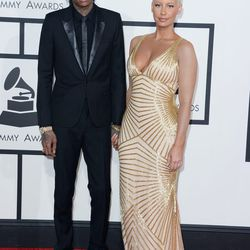 New mom Amber Rose with Wiz Khalifa. She apparently covered up her tats with makeup.