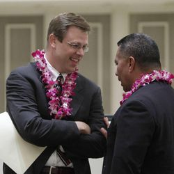 """Clark G. Gilbert, president and CEO of Deseret News and Deseret Digital Media, (left) talks with former BYU and NFL star Vai Sikahema  at the Pacific Islander conference """"Navigating the Future"""" sponsored by the Deseret News as a forum for different issues for Polynesians at the Joseph Smith Building Wednesday, Sept. 21, 2011, Salt Lake City, Utah."""