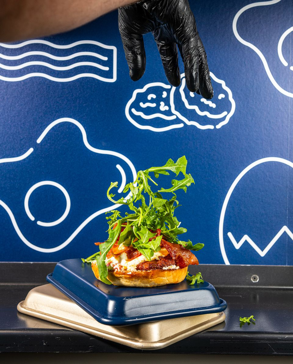 Arugula rains down on the Southern Charm sandwich