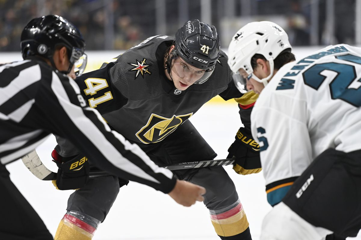 Nolan Patrick #41 of the Vegas Golden Knights faces off with Jasper Weatherby #26 of the San Jose Sharks during the third period at T-Mobile Arena on September 26, 2021 in Las Vegas, Nevada.