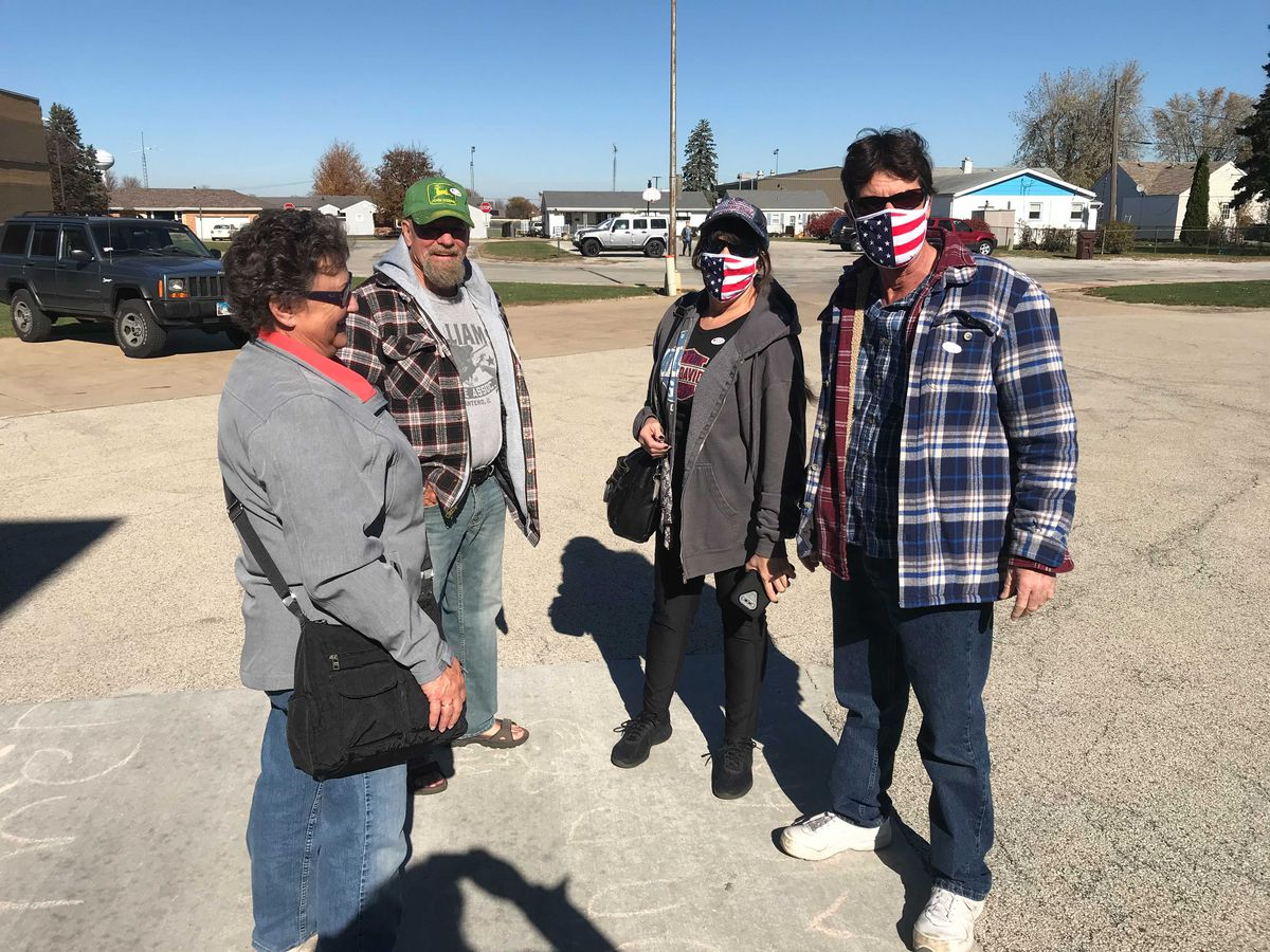 Ethel and Marty Williams with friends outside Manteno Middle School after voting Tuesday.