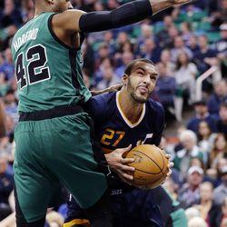 Utah Jazz center Rudy Gobert (27) is defended by Boston Celtics center Al Horford (42) during NBA basketball in Salt Lake City on Saturday, Feb. 11, 2017.