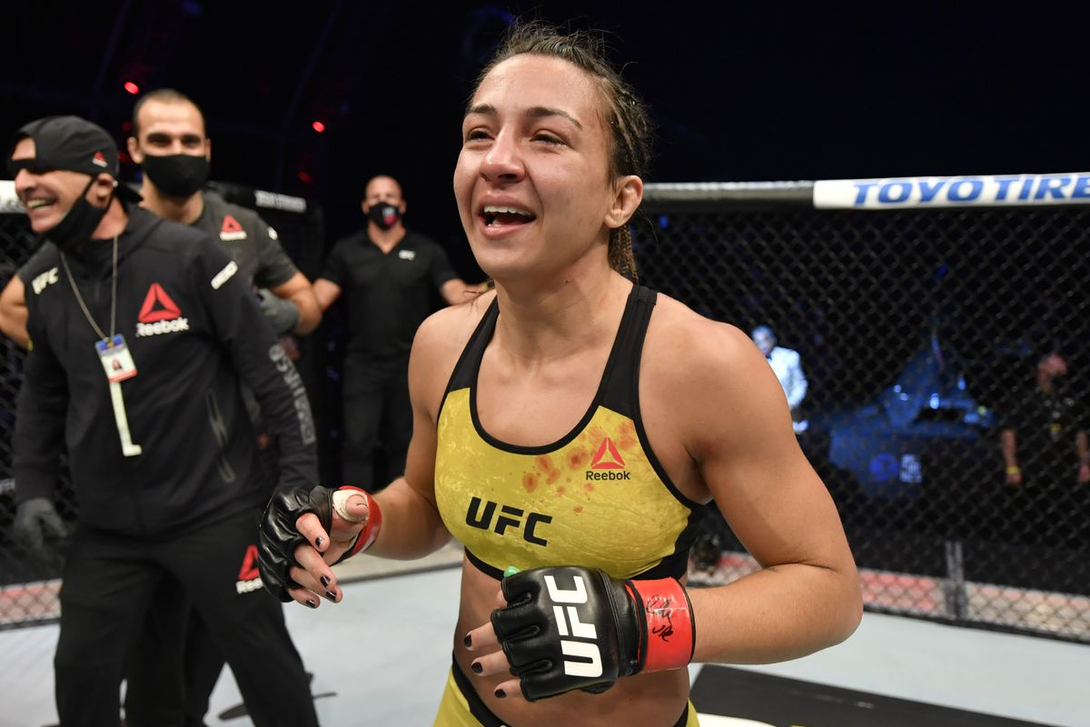In this handout image provided by UFC, Amanda Ribas of Brazil celebrates after her victory over Paige VanZant in their flyweight fight during the UFC 251 event at Flash Forum on UFC Fight Island on July 12, 2020 on Yas Island, Abu Dhabi, United Arab Emirates.