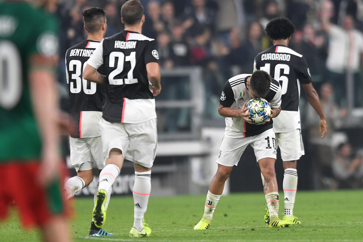 Paulo Dybala of Juventus celebrates kissing the ball after...