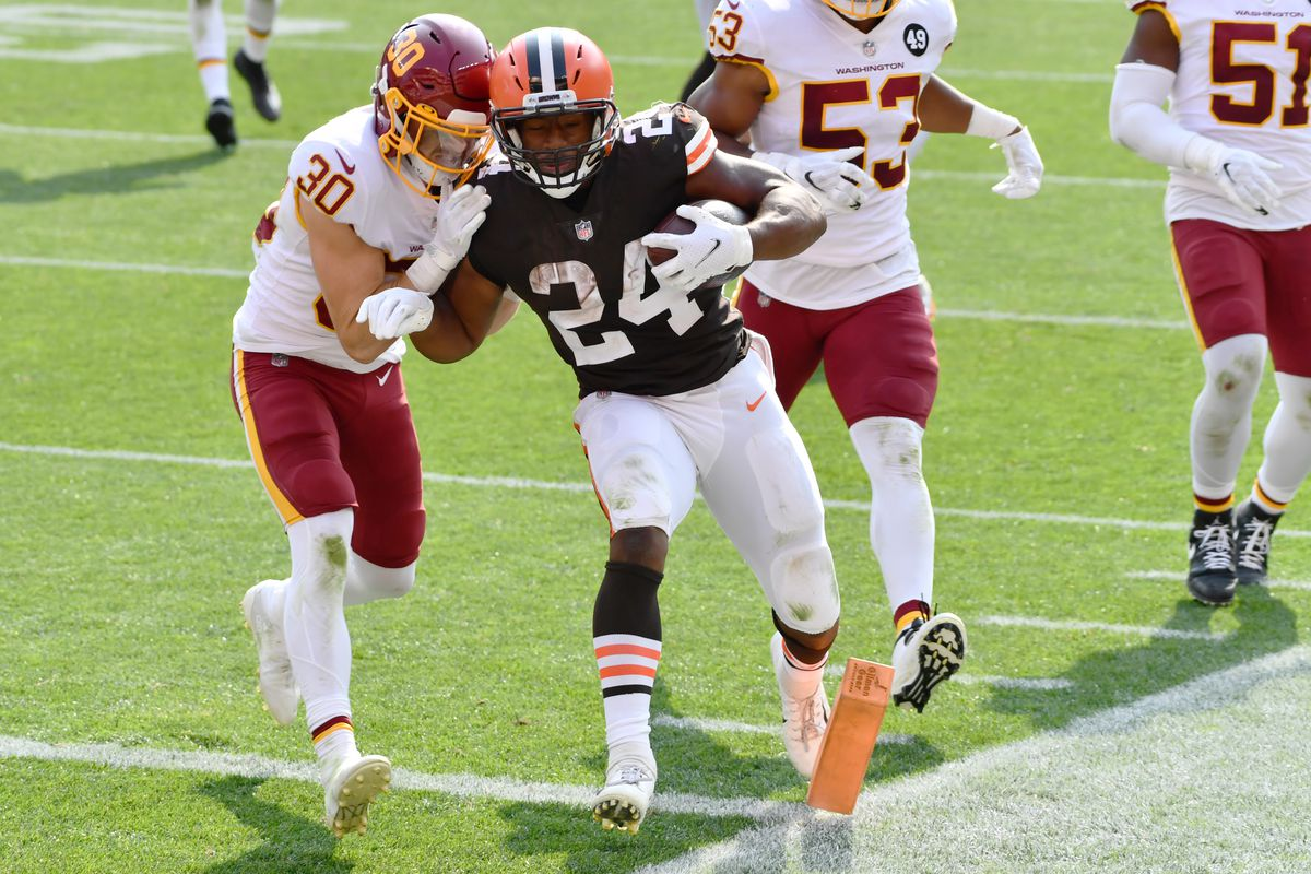Cleveland Browns running back Nick Chubb  scores a touchdown as Washington Football Team free safety Troy Apke defends during the second half at FirstEnergy Stadium