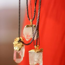 <bold>On the Rocks</bold> necklace: rock quarts hand-dipped in 24 karat gold, strung on gunmetal chain