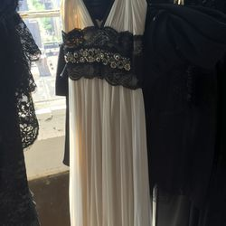 White gown with black lace detail and beaded waist, $100