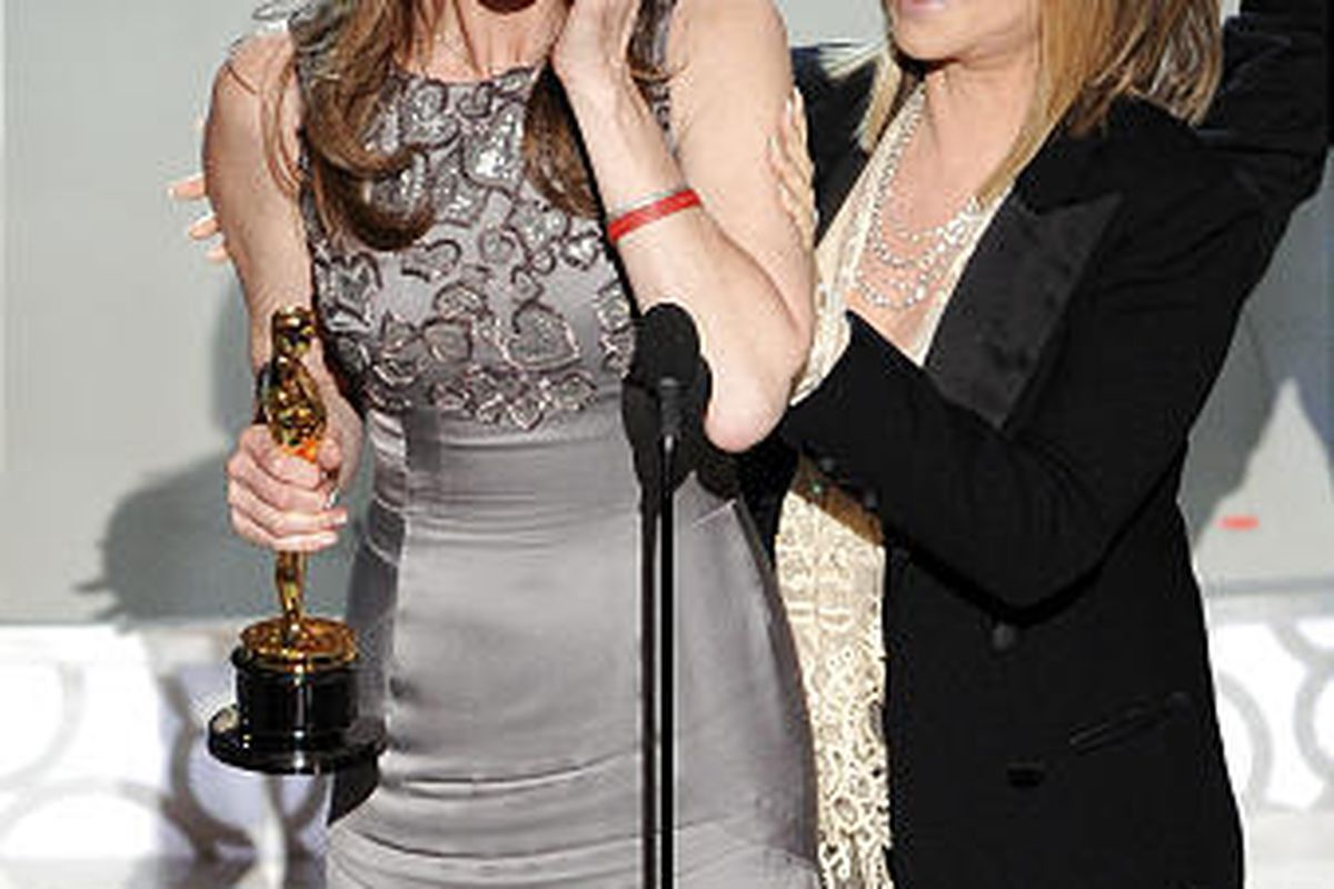 """Kathryn Bigelow accepts the Oscar for best achievement in directing for """"The Hurt Locker"""" from presenter Barbra Streisand at the 82nd Academy Awards Sunday."""