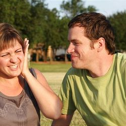 """Theresa Jordan laughs after getting kissed by her husband, Luke. A class through the Oklahoma Marriage Initiative helped the couple learn more about their """"love languages"""" and how public displays of affection aren't Theresa's favorite."""