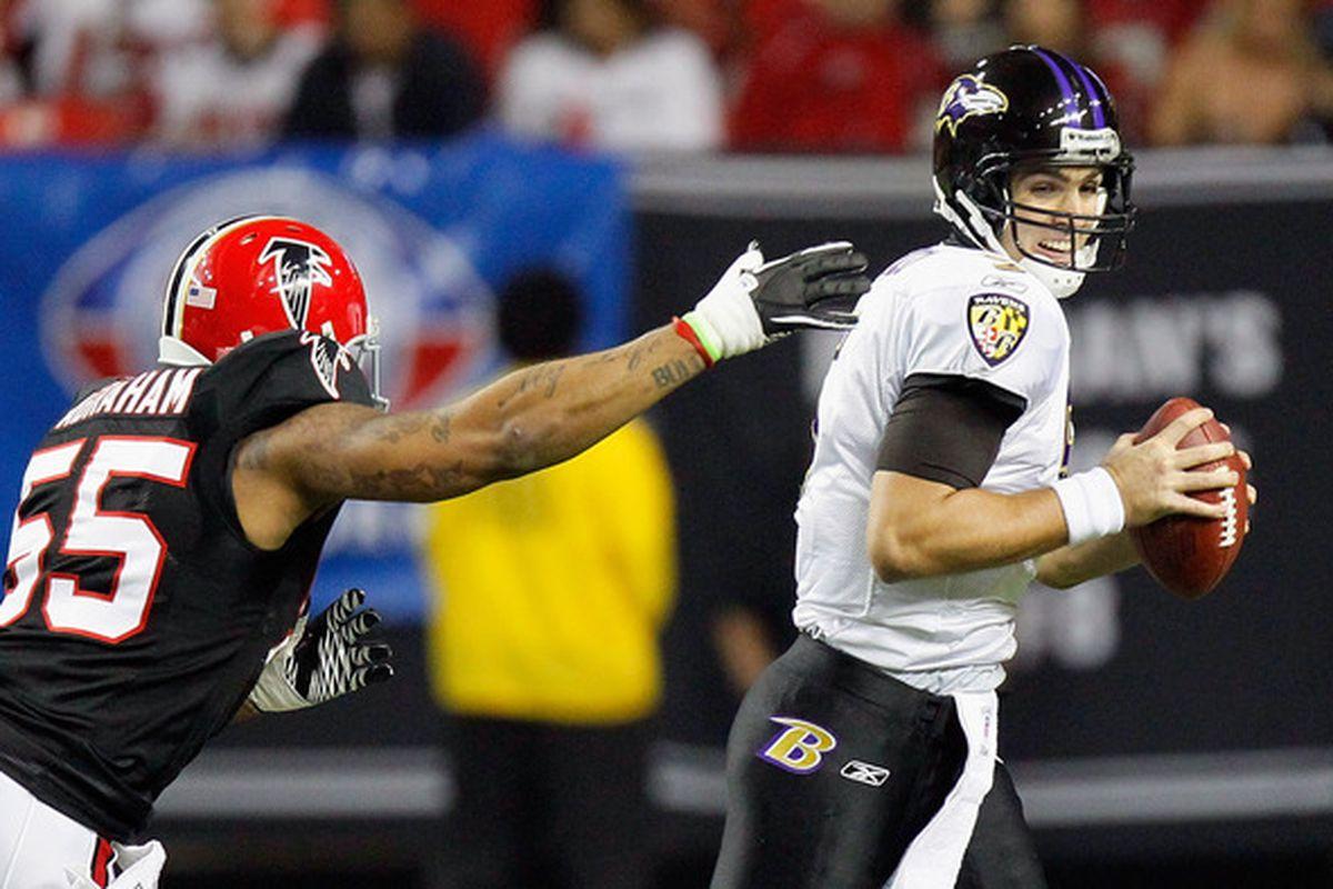 ATLANTA - NOVEMBER 11:  John Abraham #55 of the Atlanta Falcons pressures quarterback Joe Flacco #5 of the Baltimore Ravens at Georgia Dome on November 11 2010