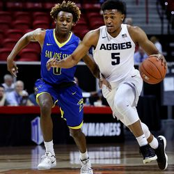 Utah State Aggies 5 Julion Pearre drives against San Jose State's Terrell Brown at the Mountain West Men's Basketball Championships at the Thomas & Mack Center, Las Vegas, Nevada on Wednesday, March 8, 2017.